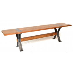 Long bench with a solid mango wood seat and steel legs in a braced cross design
