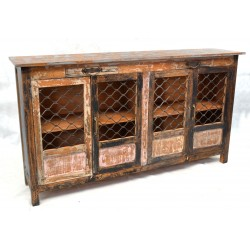 Solid wood sideboard with distressed finish and wire mesh door panels and small drawers at the top