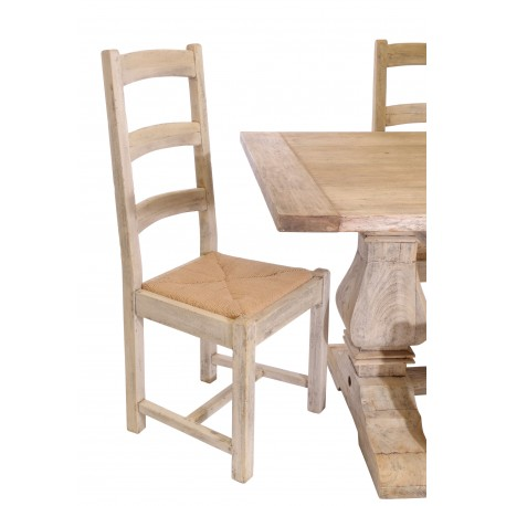 Vintage style solid wood dining chair with rattan seat in a stripped back wood finish