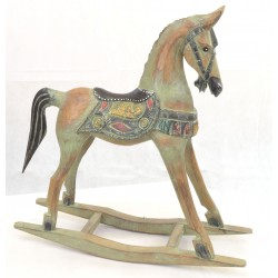 Large ornamental rocking horse with a green wash finish and ornate saddle