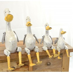 Set of 4 white ducks with yellow bills to sit on a shelf with jointed legs hanging over the edge