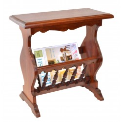 Magazine rack made from solid mahogany with a curvaseous design and spindled magazine holder
