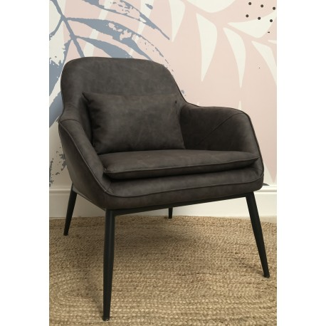 Grey faux leather low armchair with cushion and black painted metal angled leg base