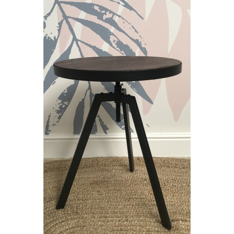 Steel and Elm adjustable table with a dark grey steel frame and round dark solid wood top on a screw thread adjuster