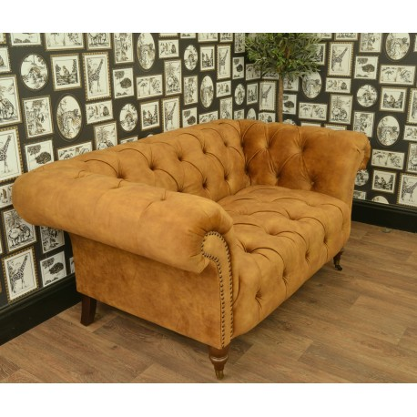 Velvet covered chesterfield design of sofa, fabric is a deep grey coloured very soft velvet