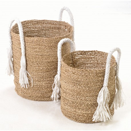 Set of 2 hand woven stackable baskets with white handles ending in tassels