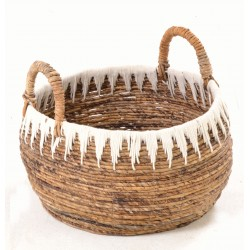 Hand woven basket with white icicle motif on a natural coloured base and handles