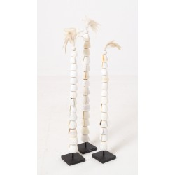 Set of three palm tree ornaments made from round shells and feathers on black rectangular stands