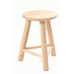 Three legged stool made in a retro mid century style with round seat and oval profile legs