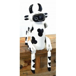 Black and White Cow to sit on a shelf with jointed legs hanging over the edge