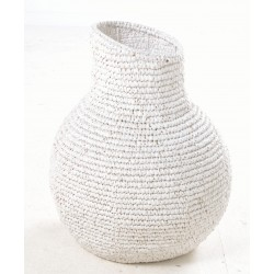 White hand woven basket in an urn or gourd shape with a slanted opening