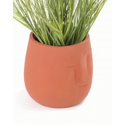 Hand made terracotta planter pot with a shallow stylised face