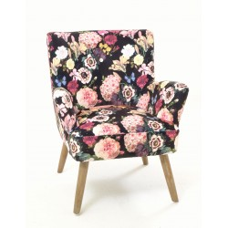 Velvet bedroom or occasional armchair with a floral pattern and distressed vintage style legs