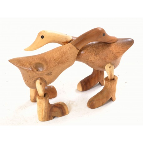 Pair of small bamboo ducks with booted feet hugging each other and with a polished laquer fininsh