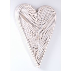 Woven rattan wall art in a 3d heart shape painted white finish